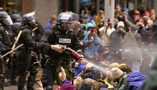 Police and WTO protests in Seattle, November 30, 1999. Image from: Steve Kaiser, Seattle, US.  http://commons.wikimedia.org/wiki/File:WTO_protests_in_Seattle_November_30_1999.jpg