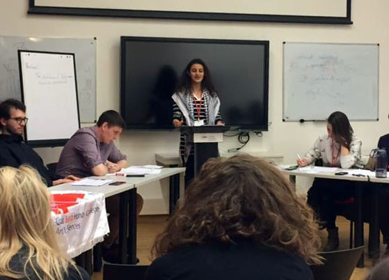 "Students from the six Bard Network campuses compete in the final debate of the conference on the topic ""Resolved: the production of fake news should be criminalized."""